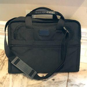 TUMI computer briefcase.